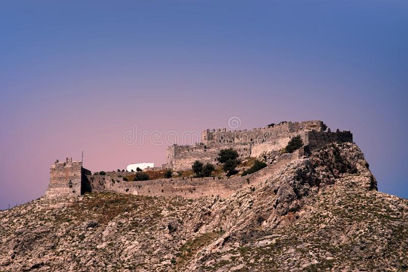 The old Venetian fortress in Leros, Dodecanese islands, Greece. Sunset view of the old Venetian fortress in Leros, Dodecanese islands, Greece royalty free stock photo
