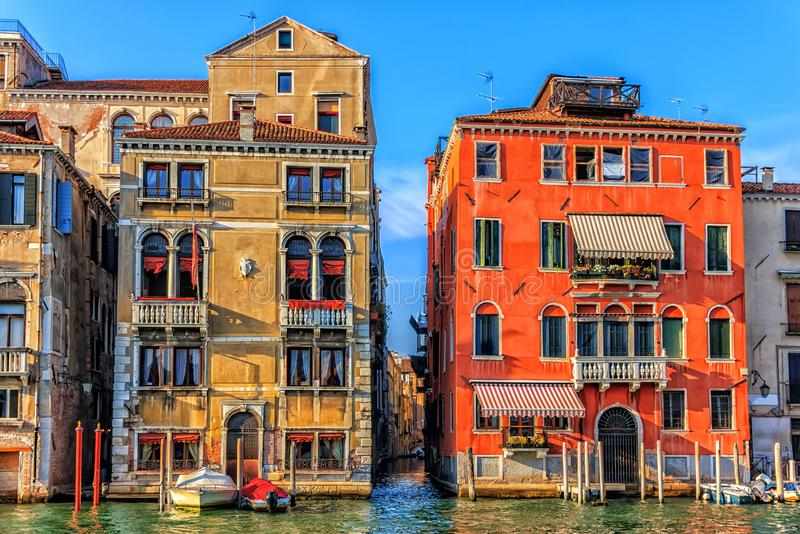 Old venetian palaces and a narrow street channel or rio between royalty free stock photo