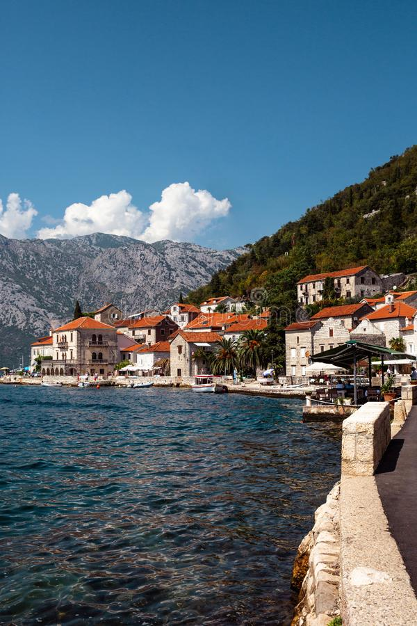 Old Venetian sea southern town with mountains in the background. Bay of Kotor. Perast. Montenegro royalty free stock photo