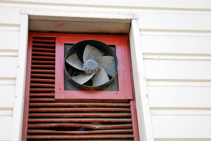 Old ventilation hood, external fan of conditioning system unit. On the wall royalty free stock photo
