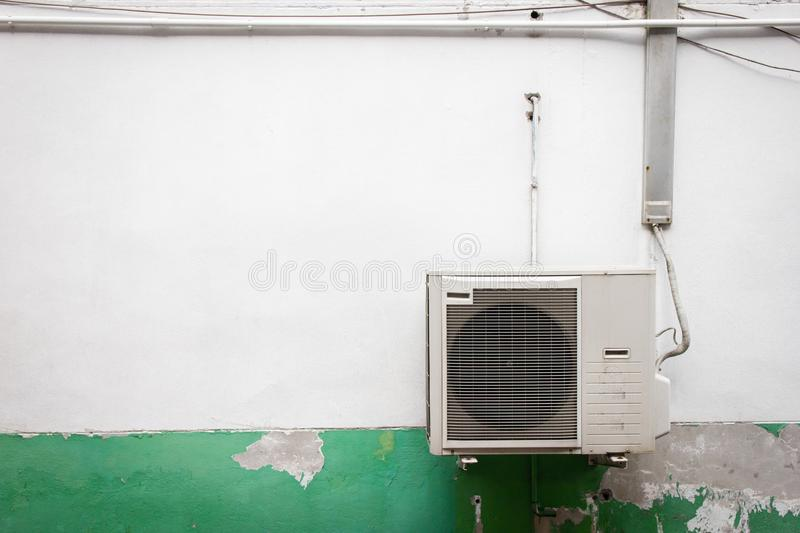 Old ventilators of air conditioning It is mounted on the outside wall. Energy-saving ideas royalty free stock photo