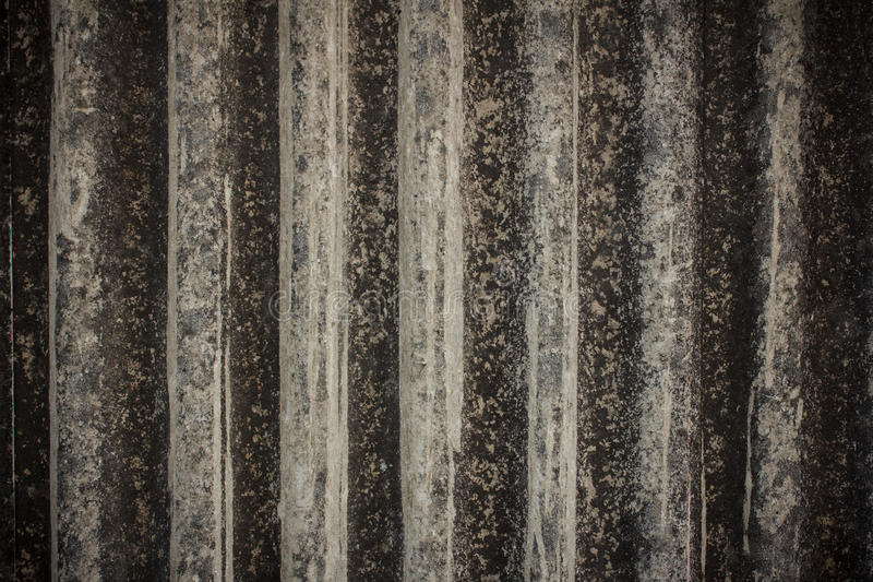 Old vertical gray asbestos roof background stock photo