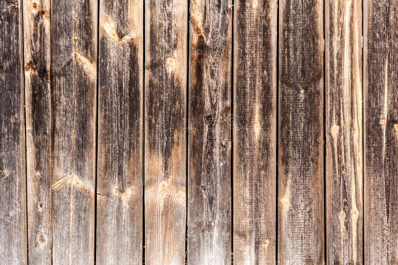 Old vertical weathered boards, texture of dark antique wood panels, decor abstraction background royalty free stock images