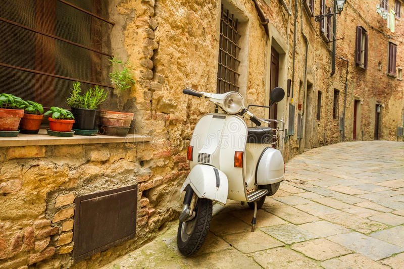 Old Vespa scooter on the street stock image
