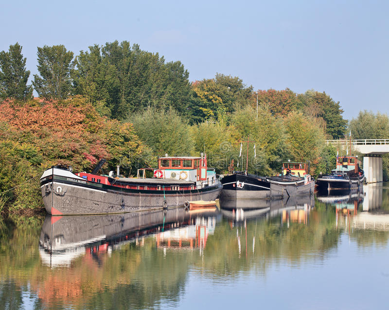 Old vessels moored in Pius Harbor, Tilburg, Netherlands royalty free stock photos