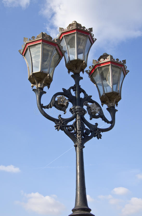 Old Victorian street light. An old glass and metal light on Putney Bridge over the River Thames in London, a grade II listed structure royalty free stock image