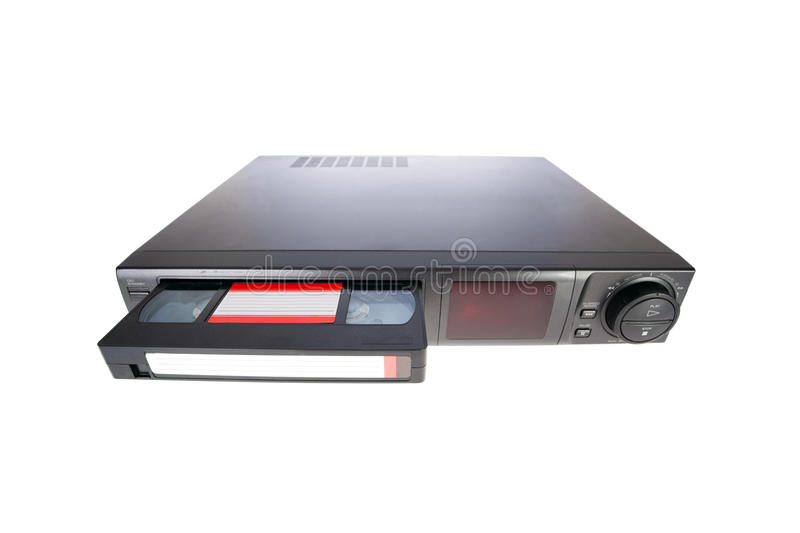 Old Video Cassette Recorder ejecting tape. Isolated on white background stock image