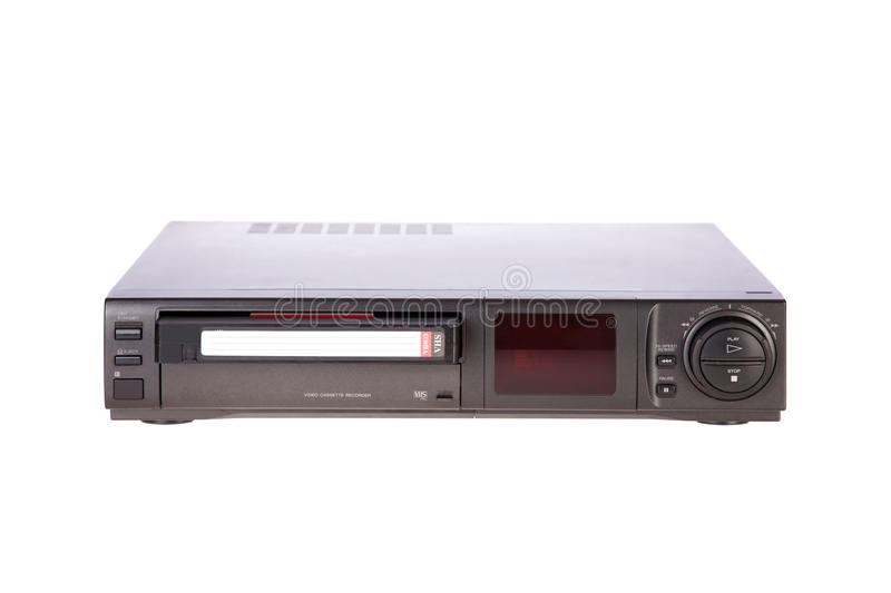 Old Video Cassette Recorder ejecting tape. Isolated on white background stock photography
