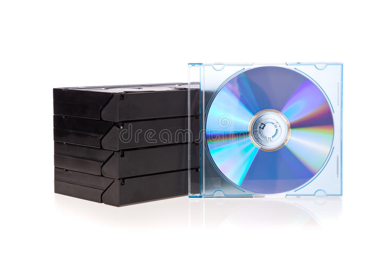Old Video Cassette tapes with a DVD disc isolated stock photography