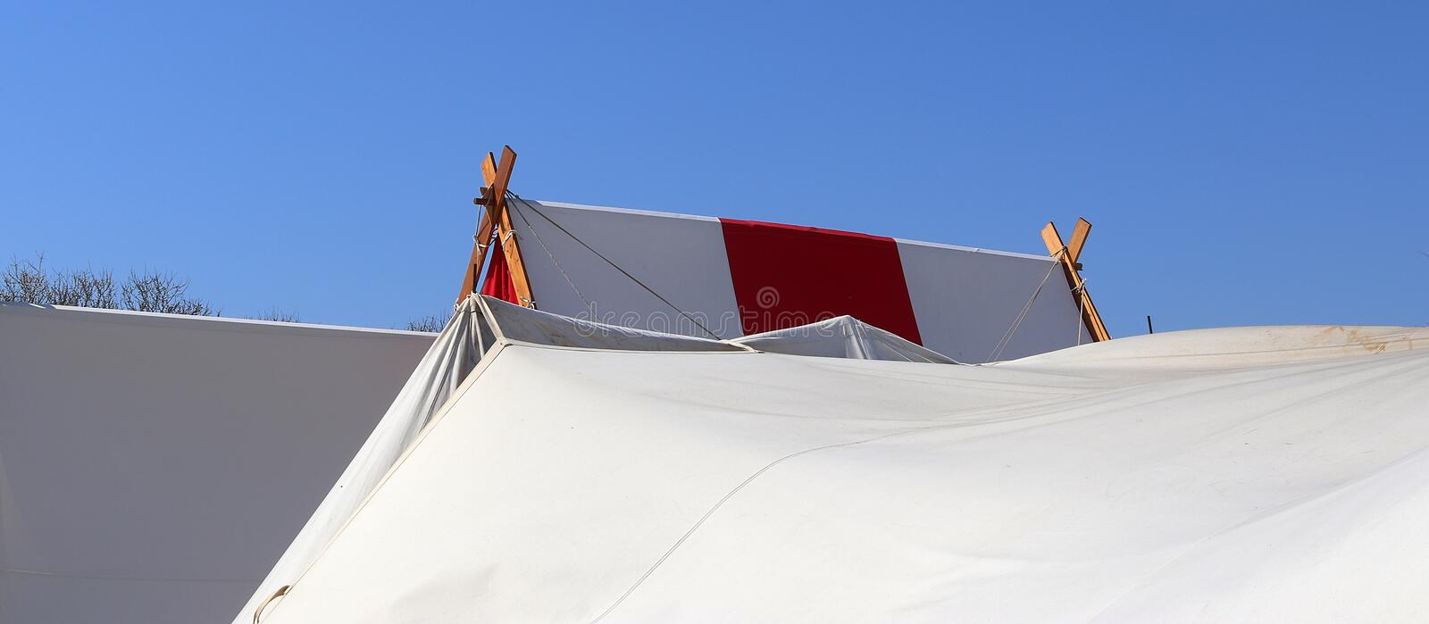 Old vikings tent made of cloth and wood in front of a blue sky royalty free stock photography