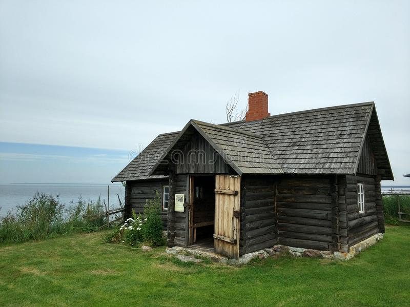 Old village house by the sea royalty free stock photo