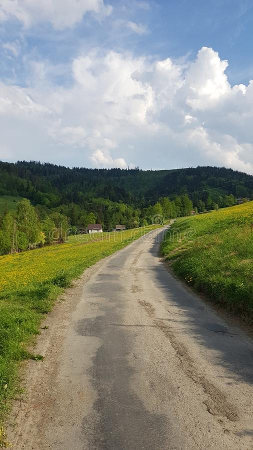 Old village road under blue sky stock photo