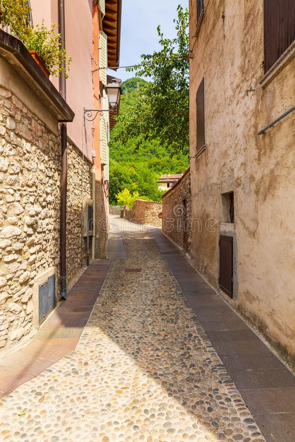Old village street view, narrow alley, old architexcture and touristic landmark at Renzano near Salo, Italy. Old village street view at Renzano near Salo stock photography