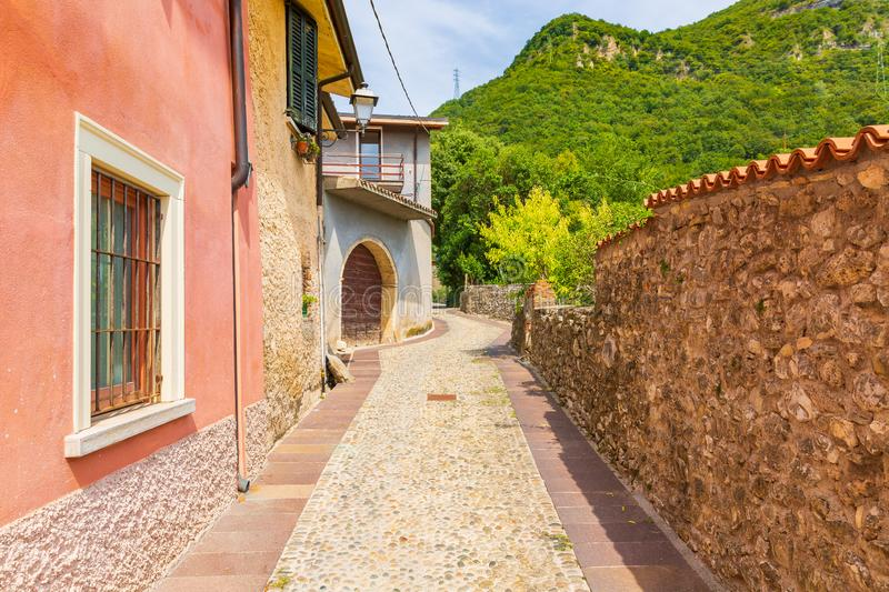 Old village street view, narrow alley, old architexcture and touristic landmark at Renzano near Salo, Italy. Old village street view at Renzano near Salo royalty free stock images