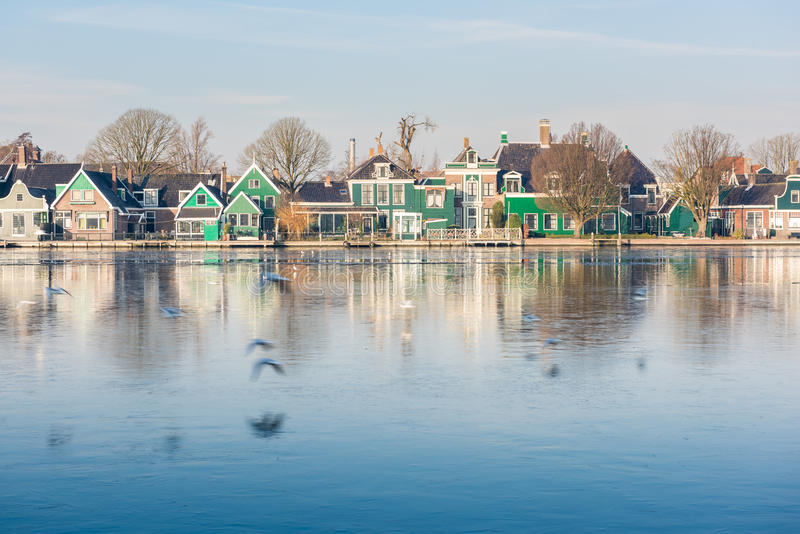 The old village of Zaan Schans. The village of Zaan Scans, Holland, famous for its wind mills, in winter, with the iced water in the river stock photos