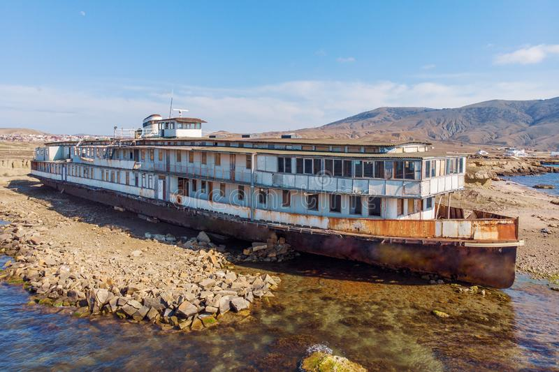 Old vintage abandoned rusted ship run aground after shipwreck accident in beginning of XX century in Crimean coast. On sand beach, aerial view from drone stock photos