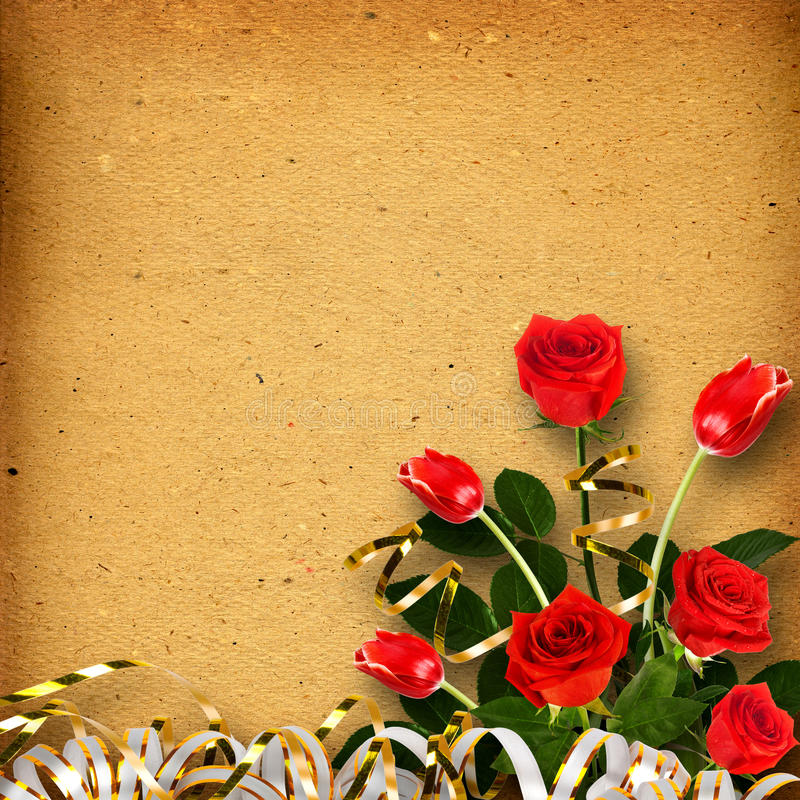 Old vintage album for photos with a bouquet of red roses stock photography