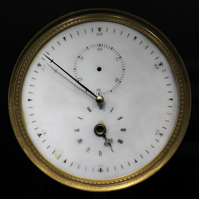 Old vintage analog stopwatch and clock, on black stock photography