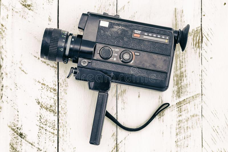 Old vintage analog video camera black colored stock photo