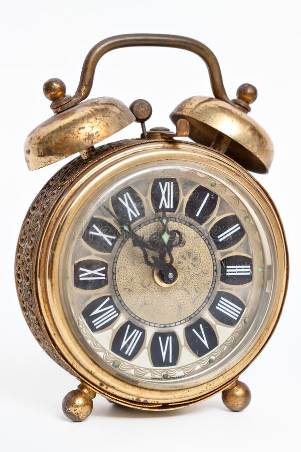 Old vintage antique alarm clock isolated