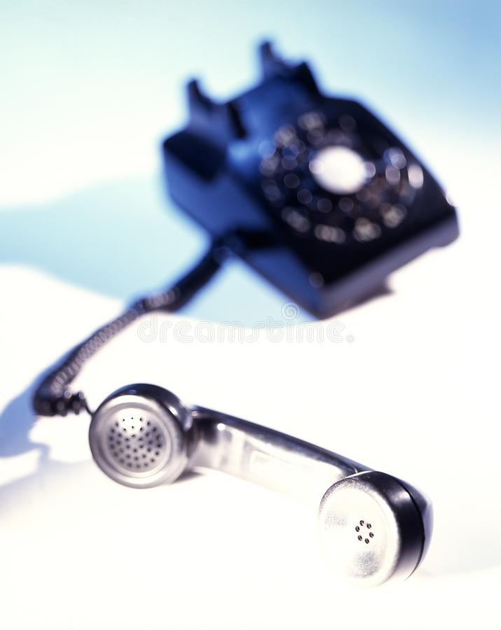 Old Vintage Antique Black Rotary Dial Telephone. Soft focus on white background stock images