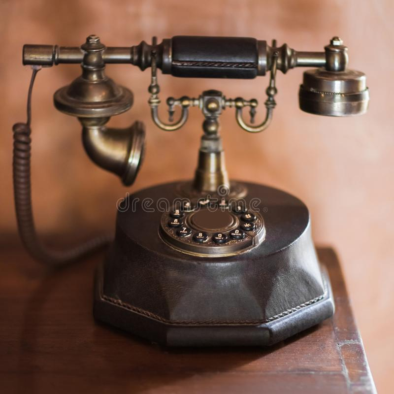 Old vintage antique bronze phone. Old-fashioned style royalty free stock image