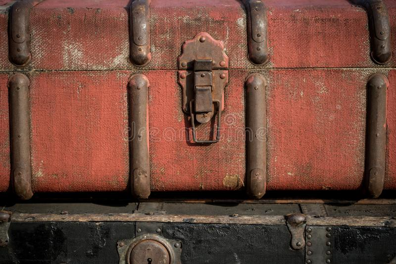 Old vintage antique suitcases trunks in a stack background. Macro shoot of old vintage antique suitcases trunks in a stack background stock image