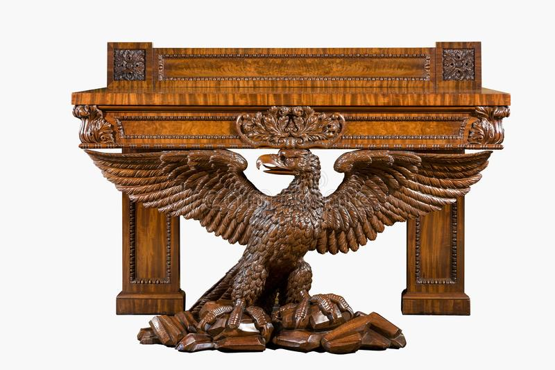 Old vintage antique table heavily carved supported by eagle wings spread stock photography