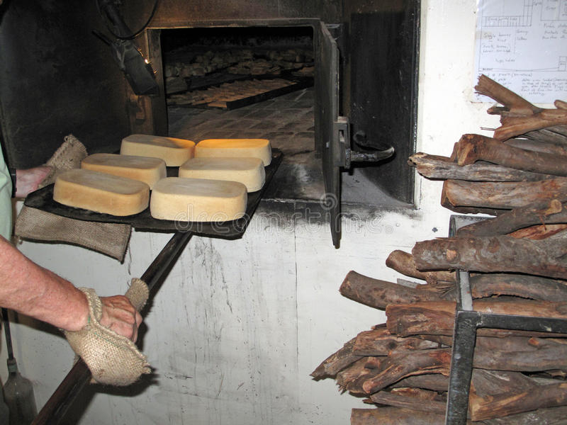 Old Vintage Bakery Oven. A still in use old 1920's Scottish baking oven with a stacked pile of cut local native Australian Mallee hardwood. Photo taken in an old stock images