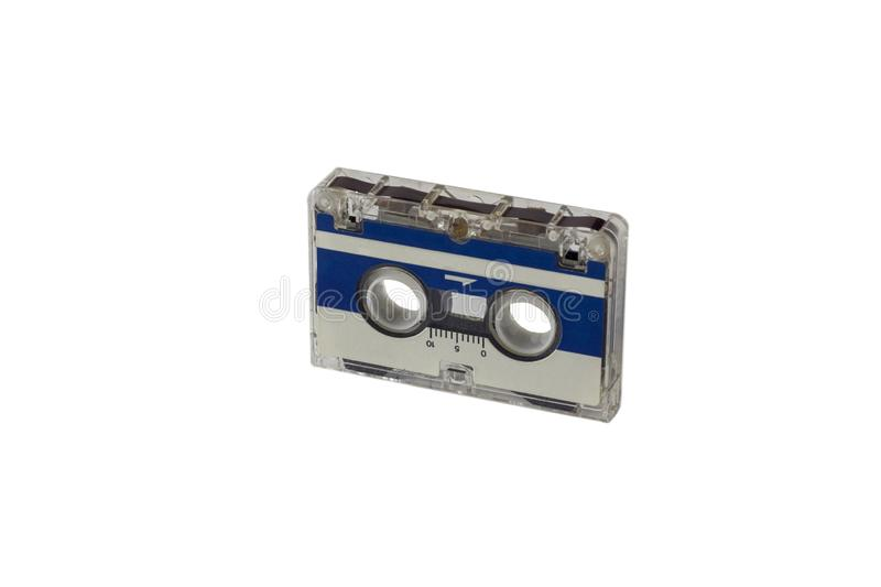 Old vintage blue small tape cassette closeup isolated on white background royalty free stock image