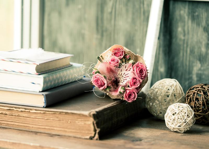 Old Vintage Books With Bouquet and Clews. Books vintage old style old fashioned retro love romance stock photos