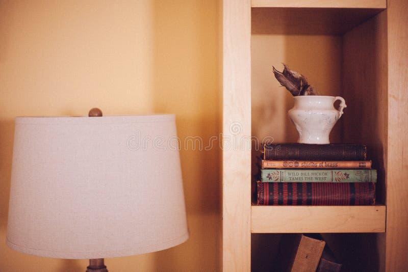 Old Vintage Books Case Wood Shelf Ikea Lamp royalty free stock photography