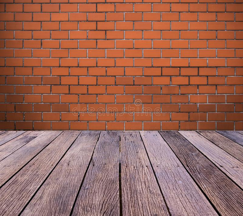 Brick wall with outdoor wooden floor. royalty free stock photos