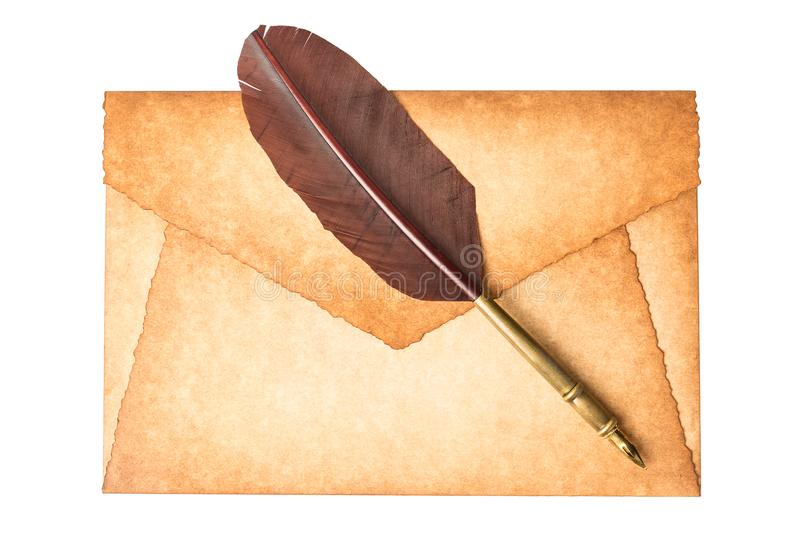 Old vintage burned envelope letter with quill feather pen isolated on a white background stock image