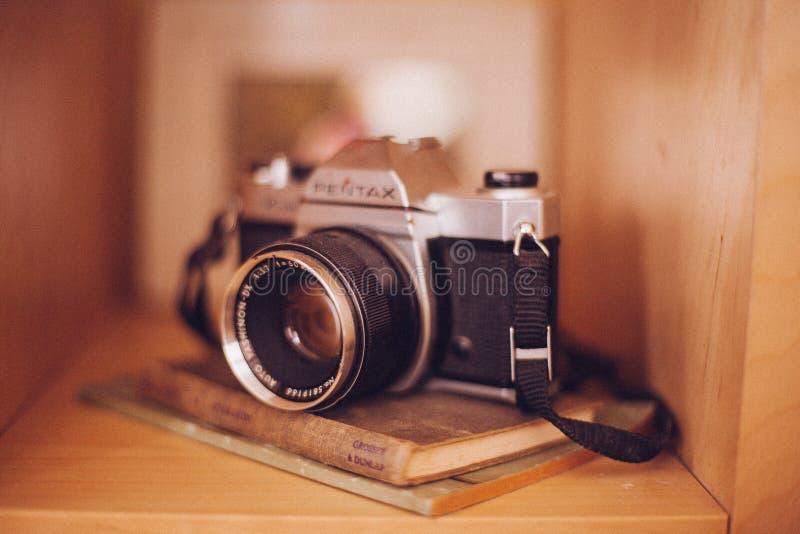 Old Vintage Camera Books Shelf Case Tan Brown 3 stock image