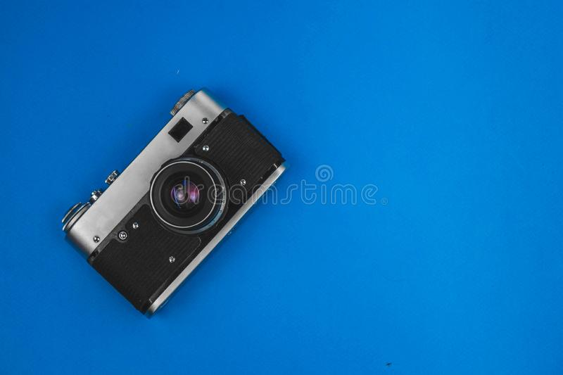 old vintage camera isolated on blue background royalty free stock images