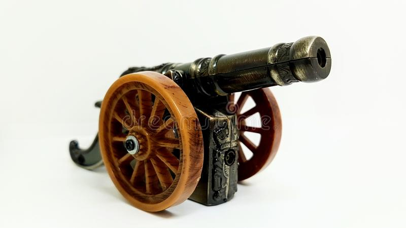 Old vintage cannon toy on white background stock image