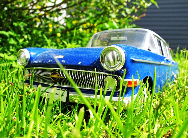 Old vintage car in high grass stock photography