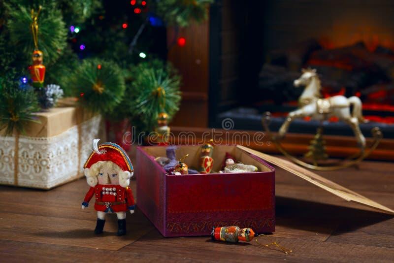 Old Vintage Christmas nutcracker for children Christmas Eve setting on dark background. Toy box royalty free stock photo