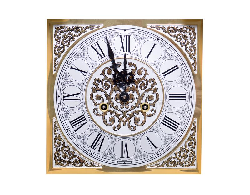 Old vintage clock shows five minutes to twelve. The concept of Christmas and New Year celebration. Clock isolated on white royalty free stock photo