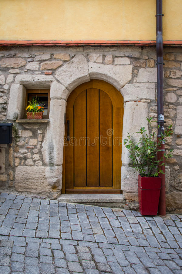 Old Vintage Cobblestone Alley Street Door Entrance Wooden Design stock photo