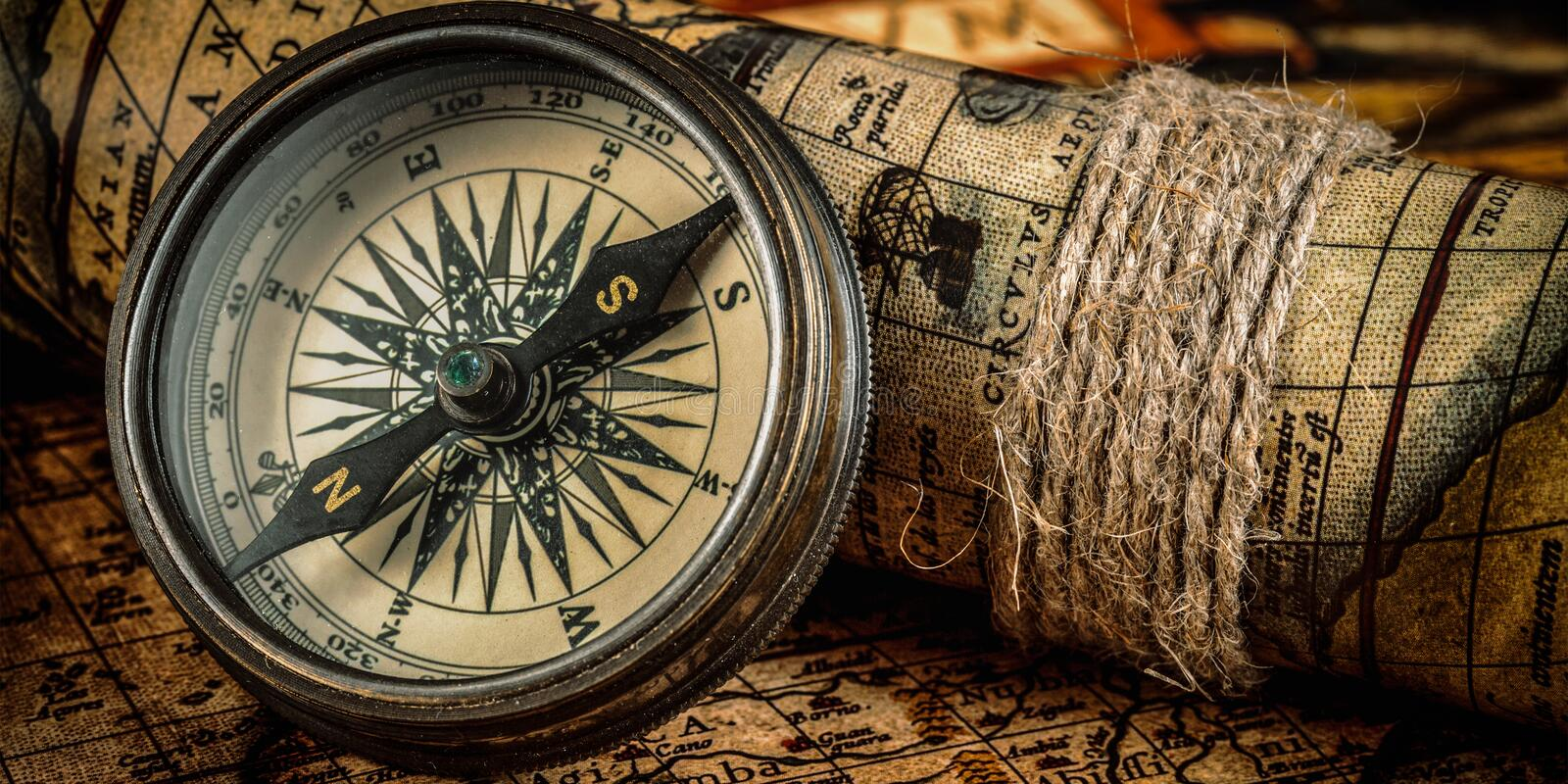 Old vintage compass on ancient map stock photo image of banner travel geography navigation concept background letterbox panorama of old vintage retro compass on ancient world map gumiabroncs Image collections