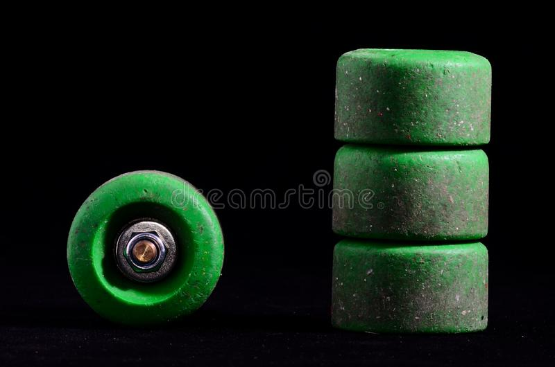 Old Vintage Consumed Skate Wheel. On a Black Background royalty free stock image