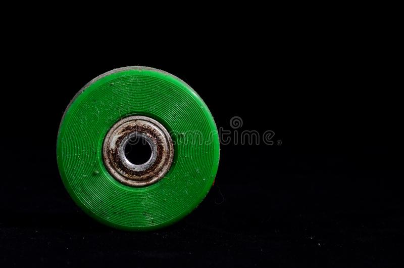 Old Vintage Consumed Skate Wheel. On a Black Background stock photos