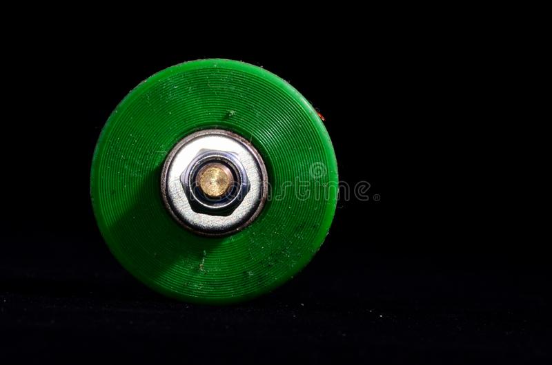 Old Vintage Consumed Skate Wheel. On a Black Background stock photography