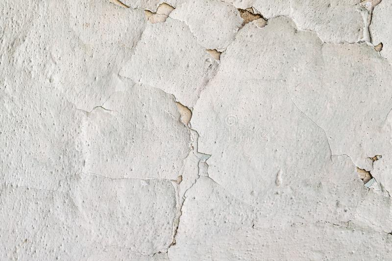 Old vintage crack wall background. Surface paint on the walls are damaged royalty free stock images