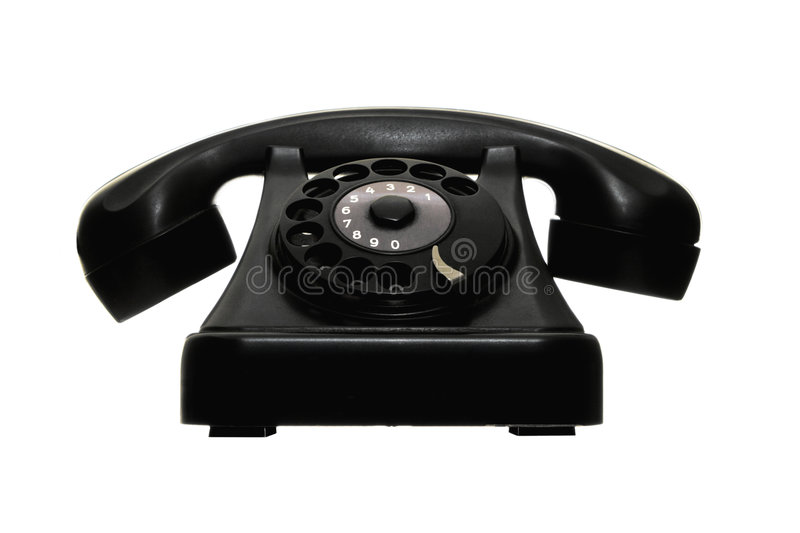 Old vintage dial telephone black. Front view of old vintage dial telephone black royalty free stock photo