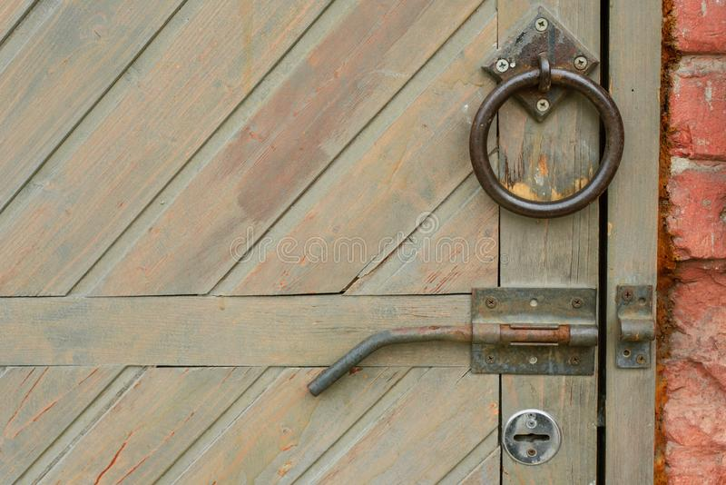 Old vintage door handle on a wooden door royalty free stock photo