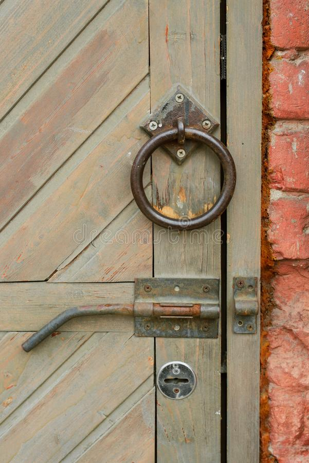 Old vintage door handle on a wooden door stock image