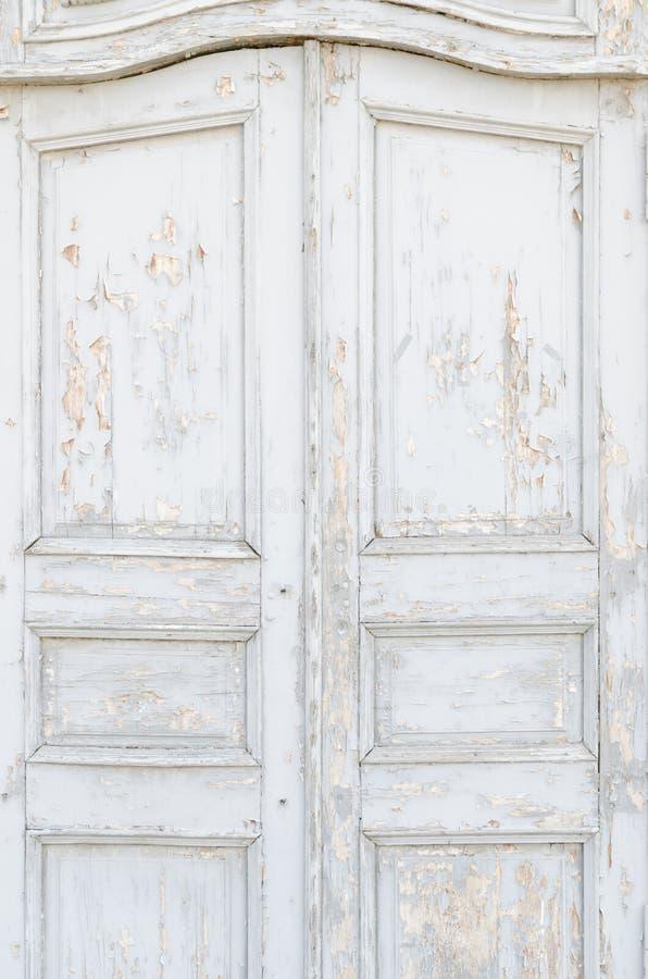 Old vintage door. Old white vintage door with peeling paint stock image